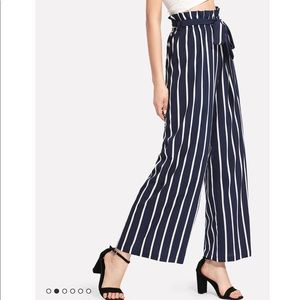 Navy and white striped wide leg pants.